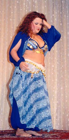 dancer in blue, white, and silver