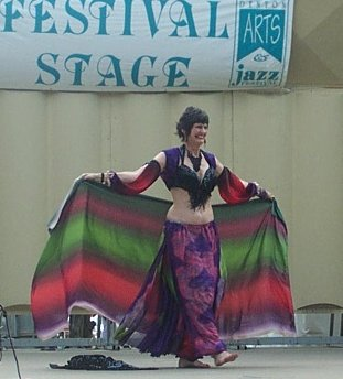 dancer in purple and black with colorful veil
