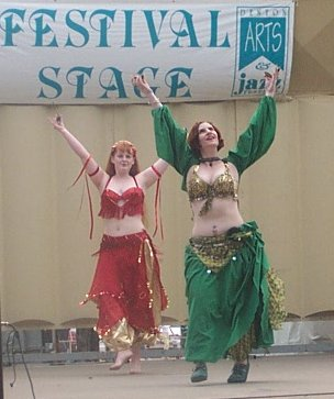 dancers in red and gold and green and antique gold