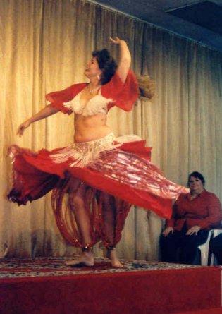 dancer in red spins