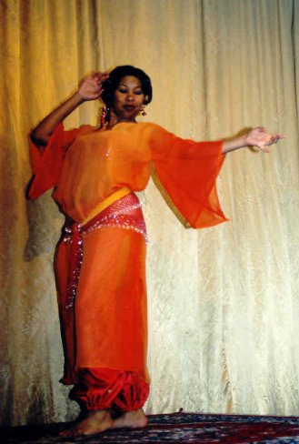 dancer in red and orange poses
