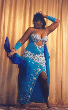 dancer in blue and silver with veil