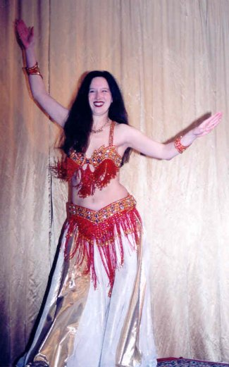 dancer in red, white and gold