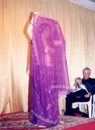 dancer in purple seen through sheer veil