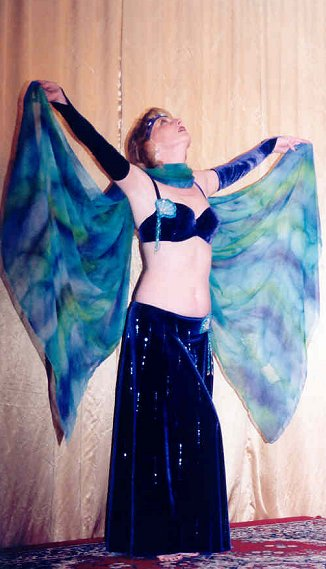 dancer in blue with outstretched veil
