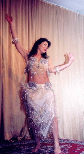 dancer in white and silver