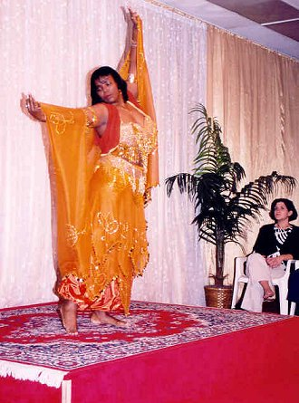 dancer in orange with outstretched veil