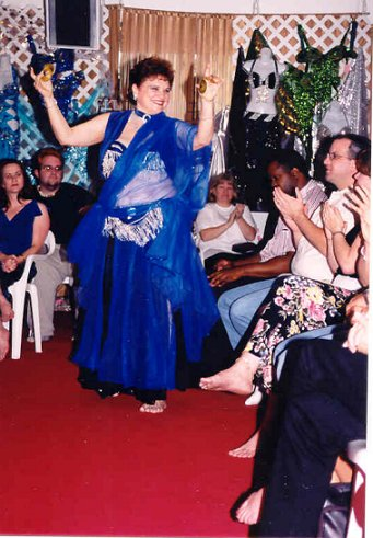 dancer in blue plays finger cymbals