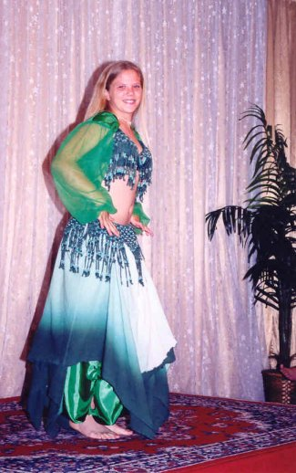 dancer in green, blue, and white