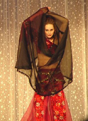 dancer in red with black veil wrap