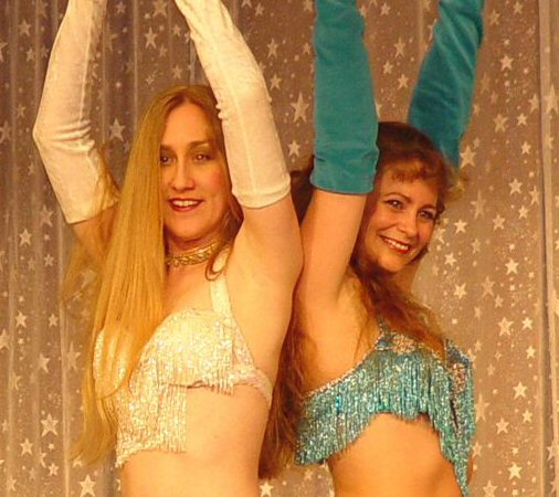 dancers in white and blue pose
