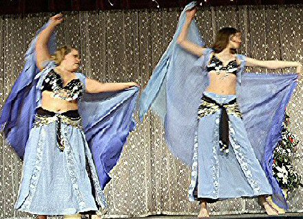 dancers in lilac/pale blue with veils
