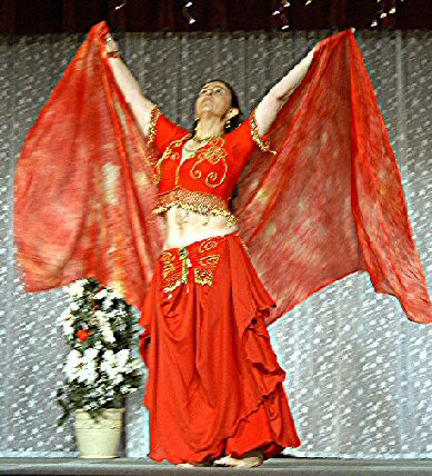 dancer in red and gold with silk veil