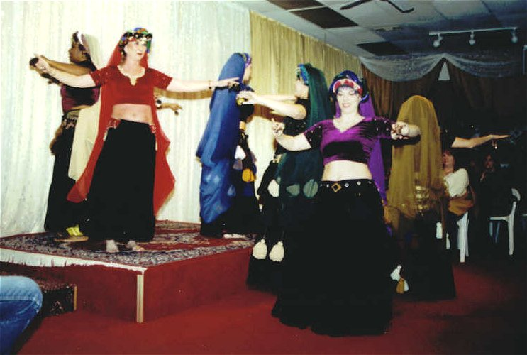 group of dancers perform with zills