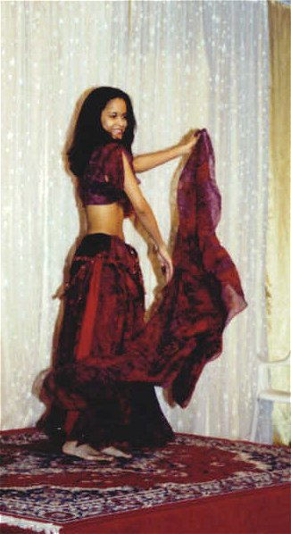 dancer in black and red with veil on stage