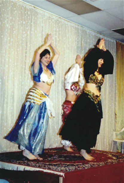 trio of dancers perform on stage
