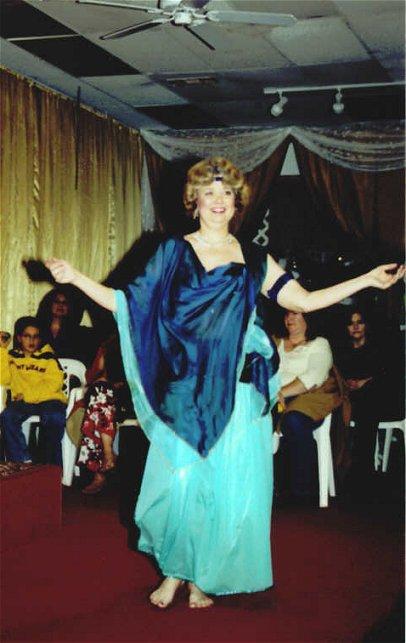 dancer in blue veil wrap performs