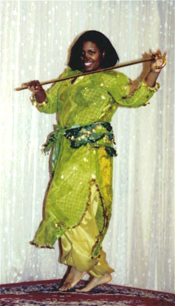 dancer in lime green performs a cane choreography