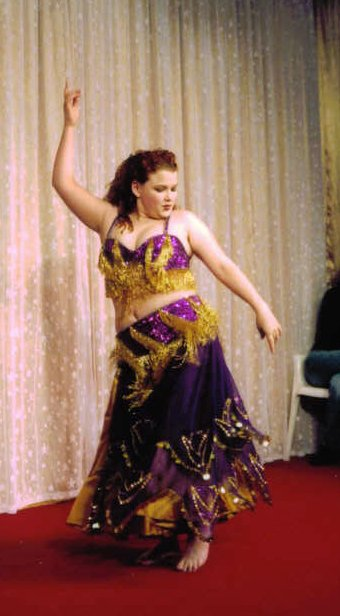 dancer wearing purple and gold on stage