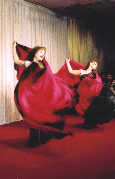 duet wrapped in red and black flowing silk veils