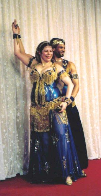 2 dancers pose together for final
