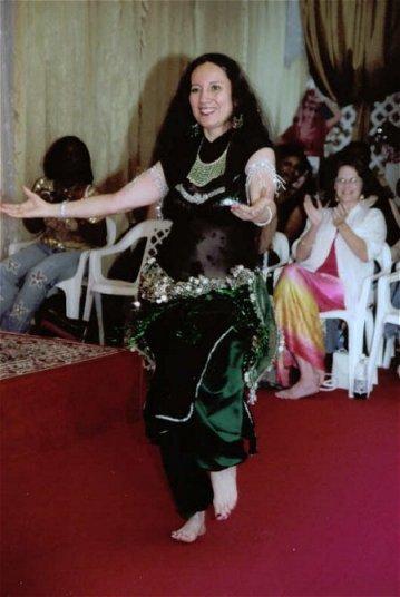 dancer in black with dark green