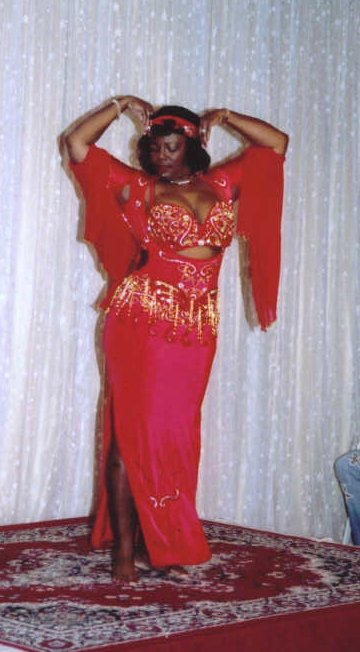dancer in red with gold accents