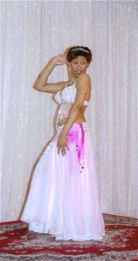 dancer in white/pink iridescent costume