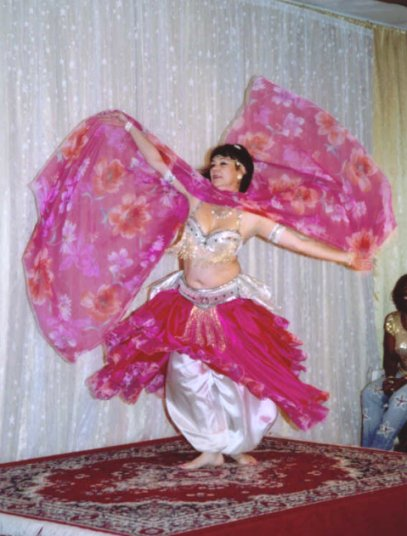 dancer in white and pink with sheer pink and floral veil