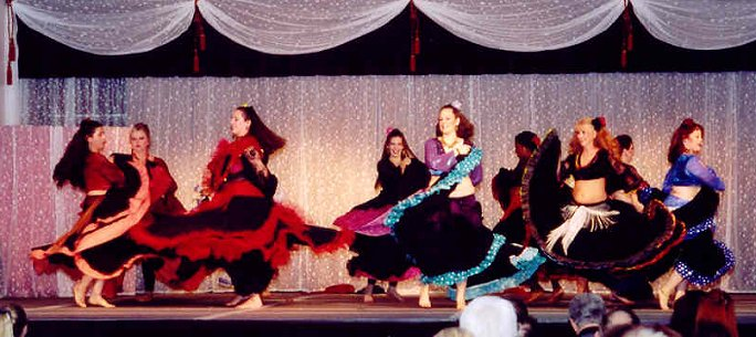 dancers spin in very full skirts