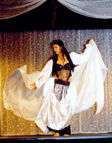 dancer in black performs with white veils