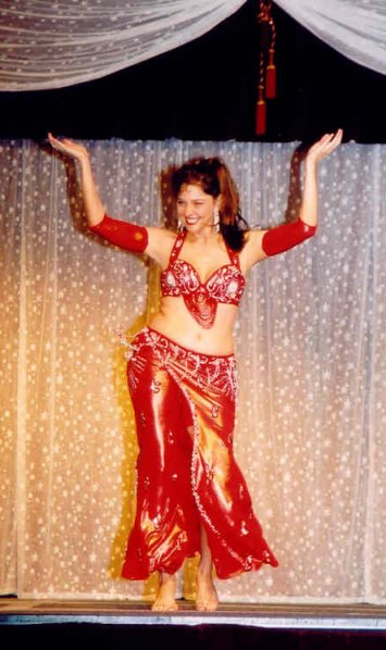 dancer in red performs with a smile