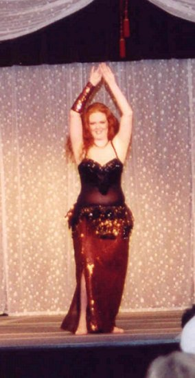 dancer in black with copper sequins