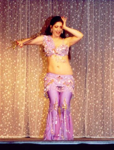 dancer in lilac pants costume